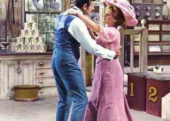 Photo from Hello Dolly! Dolly Levi and Horace Vandergelder join forces. Copyright 1968, by 20th Century Fox. All rights reserved.